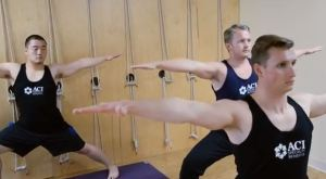 ACI's Daniel Hwang, Josh Tiernan, and Ryan Fay practice Broga in the onsite yoga studio.