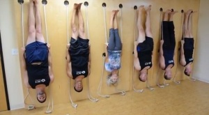 The real men of Broga take a spin on ACI's state-of-the-art yoga wall.